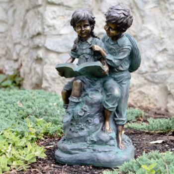Alpine Girl and Boy Reading Together Garden Statue